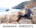 beautiful young man sitting on... | Shutterstock . vector #1038231271