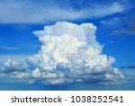 Small photo of Large cumulus cloud looks like sky ship or air castle.