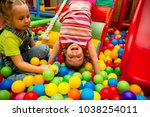 kids playing in a pool of balls | Shutterstock . vector #1038254011