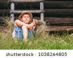 lazy boy lies in grass under...   Shutterstock . vector #1038264805