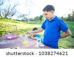 brothers coloring easter eggs | Shutterstock . vector #1038274621