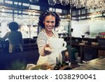 young african barista smiling... | Shutterstock . vector #1038290041