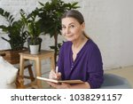 portrait of busy modern 50... | Shutterstock . vector #1038291157