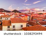 nice sunset view over cityscape ... | Shutterstock . vector #1038293494