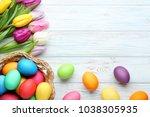 colorful easter eggs in basket...   Shutterstock . vector #1038305935