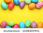 colorful easter eggs on yellow... | Shutterstock . vector #1038305941