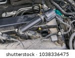 ignition coil and spark plugs... | Shutterstock . vector #1038336475