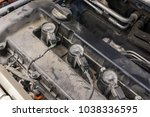 ignition coil and spark plugs... | Shutterstock . vector #1038336595
