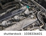 ignition coil and spark plugs... | Shutterstock . vector #1038336601