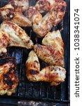 fresh roast chicken wings over... | Shutterstock . vector #1038341074