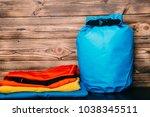 swimming waterproof bag and... | Shutterstock . vector #1038345511