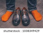 a man tries on classic leather... | Shutterstock . vector #1038349429