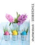 easter eggs on a blue wooden... | Shutterstock . vector #1038352411