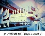a female scientist near the... | Shutterstock . vector #1038365059