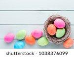 pastel easter eggs background.... | Shutterstock . vector #1038376099
