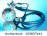 globe and stethoscope on blue | Shutterstock . vector #103837661