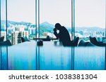 silhouette of depressed male... | Shutterstock . vector #1038381304
