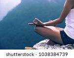 one woman practicing yoga at... | Shutterstock . vector #1038384739