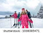 young girl with family on ski... | Shutterstock . vector #1038385471