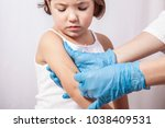 nurse vaccinating 3 years old... | Shutterstock . vector #1038409531