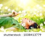 beautiful young woman lying on... | Shutterstock . vector #1038413779