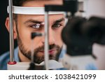 handsome young man is checking...   Shutterstock . vector #1038421099