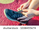 shoelaces being tied into braid....   Shutterstock . vector #1038455674