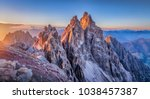 Panoramic view of famous Dolomites mountain peaks glowing in beautiful golden evening light at sunset in summer, South Tyrol, Italy - stock photo