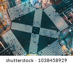 aerial view of people crossing... | Shutterstock . vector #1038458929
