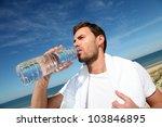 portrait of jogger drinking... | Shutterstock . vector #103846895