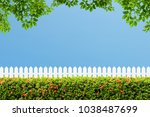 white wooden fence and green... | Shutterstock . vector #1038487699