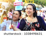 lady take a picture happily... | Shutterstock . vector #1038498631