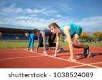 athletes at the sprint start... | Shutterstock . vector #1038524089