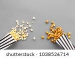 popcorn in paper bag scattered... | Shutterstock . vector #1038526714