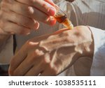 arab woman applying perfume on... | Shutterstock . vector #1038535111
