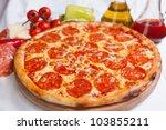 pizza diavola salamy | Shutterstock . vector #103855211