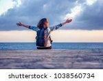 portrait of a beautiful happy... | Shutterstock . vector #1038560734