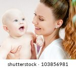 young mother with a charming... | Shutterstock . vector #103856981