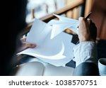 sheets of paper  businessman ... | Shutterstock . vector #1038570751