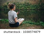 woman alone in nature listening ... | Shutterstock . vector #1038574879