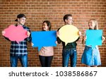 friends holding up copyspace... | Shutterstock . vector #1038586867