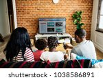 african family watching... | Shutterstock . vector #1038586891