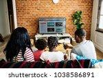 african family watching...   Shutterstock . vector #1038586891
