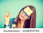 thinking woman with big nerdy... | Shutterstock . vector #1038594781