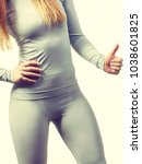 Small photo of Clothing fashion sport concept. Fit female wearing thermoactive underwear top. Slim woman in sporty clothes