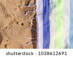 beach towel on the sand | Shutterstock . vector #1038612691