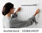 woman checking the calendar | Shutterstock . vector #1038614029