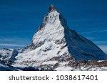 the matterhorn is a mountain of ... | Shutterstock . vector #1038617401