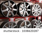 stand with alloy wheels in... | Shutterstock . vector #1038620287