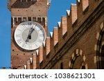 Detail of the medieval clock tower of Lamberti (Torre dei Lamberti) (XI century - 84 m.) in Verona (UNESCO world heritage site) - Veneto, Italy